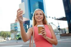 Woman with coffee taking selfie by smartphone Royalty Free Stock Photos