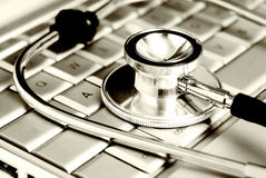 Technology and medicine - Silver stethoscope over royalty free stock photography