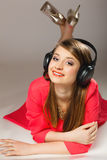Technology, music - smiling teen girl in headphones Stock Photo