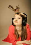 Technology, music - smiling teen girl in headphones Royalty Free Stock Photography