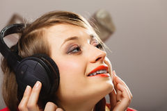Technology, music - smiling young girl in headphones Royalty Free Stock Images
