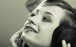 Technology, music - smiling young girl in headphones Royalty Free Stock Photo