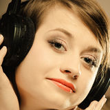 Technology, music - smiling young girl in headphones Stock Images