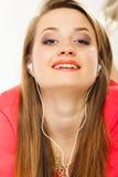 Technology, music - teen girl in earphones Stock Photography