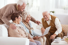 Technology in nursing home. Group of elderly people using new technology in nursing home Stock Images
