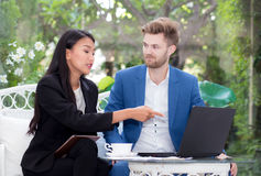 Technology and office concept - two business man and woman with labtop. Royalty Free Stock Photo