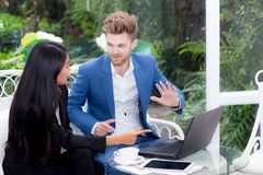 Technology and office concept - two business man and woman with labtop. Royalty Free Stock Photography