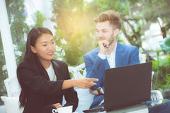 Technology and office concept - two business man and woman with labtop. Stock Photography
