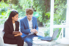 Technology and office concept - two business man and woman with labtop. Stock Photo