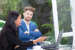 Technology and office concept - two business man and woman with laptop. Royalty Free Stock Photo