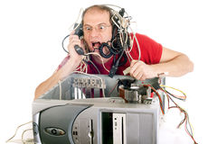 Technology panic. Man in panic with his computer trying to reach hotline Royalty Free Stock Image