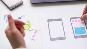 Woman working on smartphone interface design stock video footage