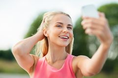 Happy woman taking selfie with smartphone outdoors Royalty Free Stock Images