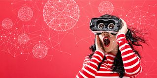 Technology Polygonal Spheres with woman using a virtual reality headset Stock Images