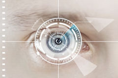 Technology scan man's eye for security. Or identification.Eye with scanner and computer interface Royalty Free Stock Image