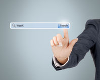 Technology, searching system and internet concept - woman hand. Pressing Search button stock image