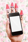 Technology of smart phone for Christmas background with human finger concept Royalty Free Stock Photography