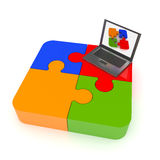 Technology solutions. Jigsaw puzzle on notebook screen representing teamwork and success Royalty Free Stock Photography