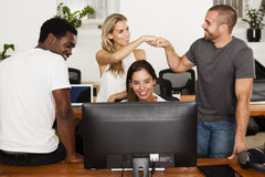 Technology startup team celebrates good news. In their office Stock Photography