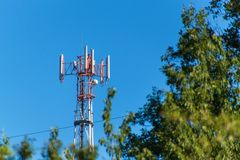 Technology on the top of the telecommunication GSM. Masts for mobile phone signal. Tower with antennas of cellular communication o Royalty Free Stock Photo