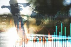 Technology and trade concept. Side view of laptop on abstract blurry sunny outdoor background with forex chart. Technology and trade concept. Double exposure Royalty Free Stock Images