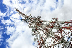 Technology transmission tower. Antenna and a blue sky with clouds on the background Royalty Free Stock Images