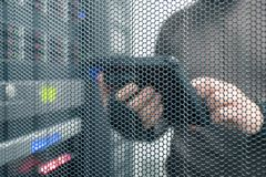 IT technology unfocused background with space for text, IT specialist with tablet in the server room. IT technology unfocused background with copy space for text royalty free stock images