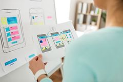Close up of ui designer with templates at office royalty free stock photo