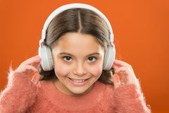 The technology uses focused sound waves. Small child wearing wireless stereo headphones. Technology and music. Stereo. Sound technology. Modern technology royalty free stock images