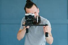 Technology video shoot man hold camera equipment royalty free stock photos