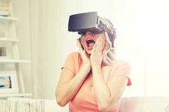 Woman in virtual reality headset or 3d glasses. Technology, virtual reality, cyberspace, entertainment and people concept - happy amazed young woman in virtual Royalty Free Stock Photo
