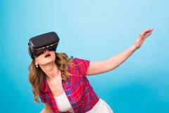 Technology, virtual reality, entertainment and people concept - happy young woman with virtual reality headset Royalty Free Stock Image