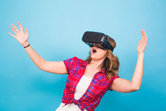 Technology, virtual reality, entertainment and people concept - happy young woman with virtual reality headset Royalty Free Stock Photography