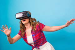 Technology, virtual reality, entertainment and people concept - Woman with virtual reality goggles Stock Images
