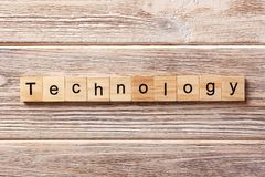Technology word written on wood block. Technology text on table, concept stock images