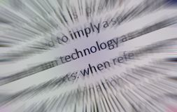Technology Zoom. Close up of a computer screen with a zoom effect centered on the word technology Stock Photos