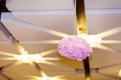 techo moderno con la lámpara de papel rosada Imágenes de archivo libres de regalías