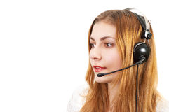 Techsupport girl on the phone. Cute techsupport girl talking on the phone using headset Stock Photography