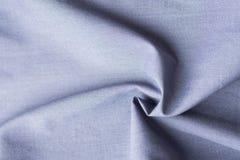 Tecido de algodão orgânico puro bonito apresentado no teste padrão espiral concêntrico Cor pastel cinzenta azul elegante sewing fotografia de stock