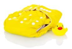 Tecidos modernos de pano e pato de borracha isolados no branco Foto de Stock