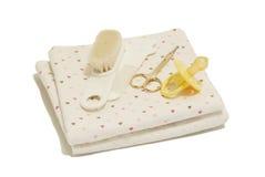 Tecidos, tesouras do prego, pentes e bocal Imagens de Stock