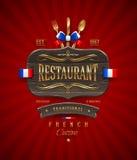 Tecken av den franska restaurangen med den guld- dekoren Arkivbild