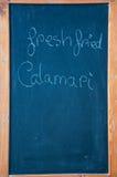 Tecken av en restaurang som visar den nya tioarmade bläckfisken Fotografering för Bildbyråer