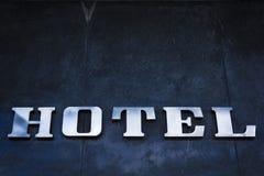 Tecken av ett hotell. Arkivfoto