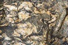 Tecken av tiden på stenen Arkivfoto