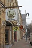 Tecken för affärer längs den 6th gatan i Austin, Texas Fotografering för Bildbyråer