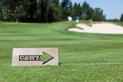 Tecken för bana för Golfvagn Arkivbild