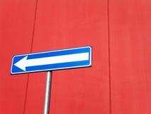 tecken för blå red för pil arkivfoton