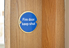 Tecken för branddörr Royaltyfri Foto