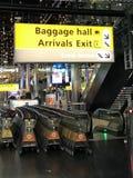 Tecken för destination för bagagekorridor arkivfoto